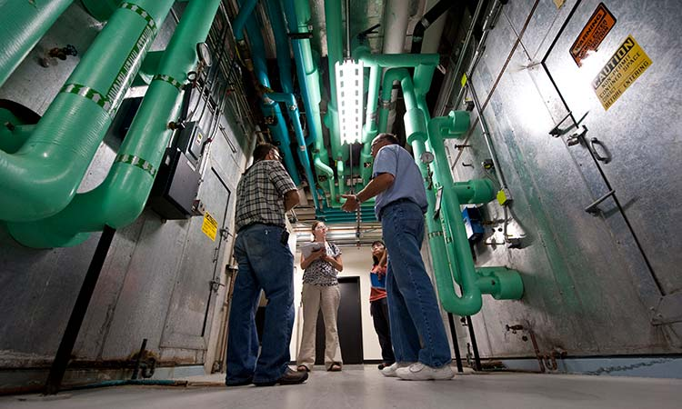 A team of engineers perform an energy audit of large HVAC systems.